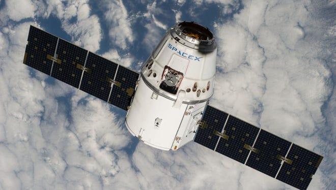 A SpaceX Dragon cargo craft in orbit.