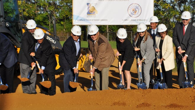 Members of the Lyndhurst Board of Commissioners and Board of Education broke ground on the $53 million Lyndhurst Junior High School on Oct. 11, 2016, at Matera Field.