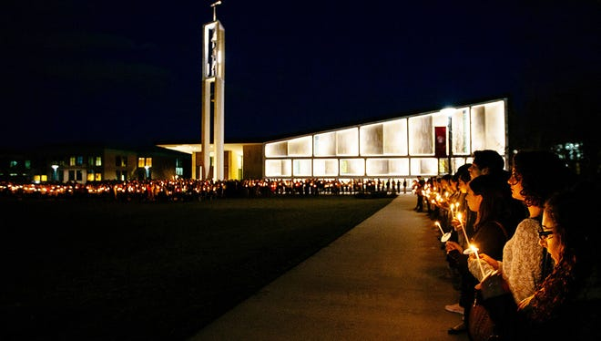 Sacred Heart University students participate in a candlelight vigil in memory of student Caitlin Nelson on the school's campus in Fairfield, Conn. Police said Nelson, from Clark, N.J., died days after choking during a pancake-eating contest at the college.