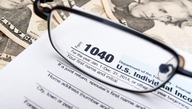 Individual tax return form 1040 for 2014.