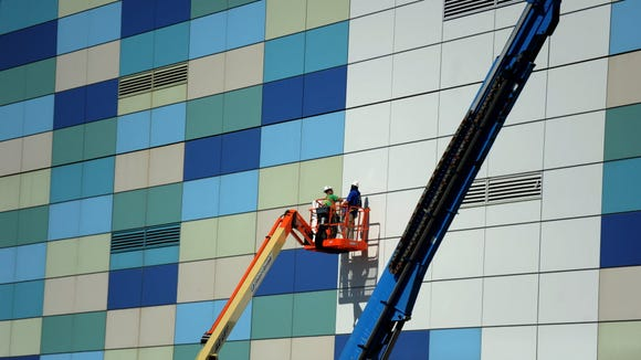 Workers began revising the multi-colored exterior of