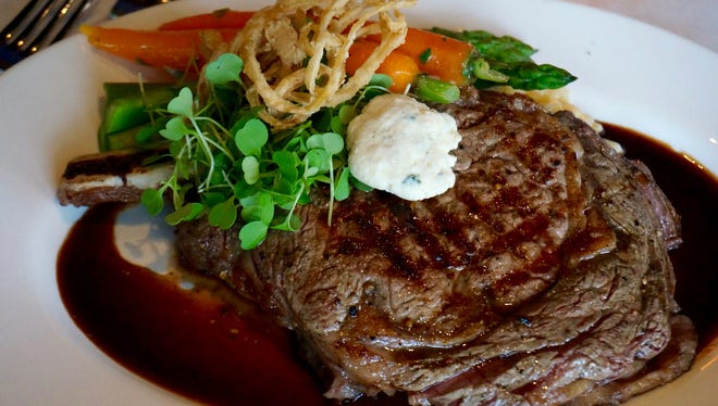 Look for the succulent Cowboy cut bone-in ribeye with mashed potatoes and green beans as a featured item.