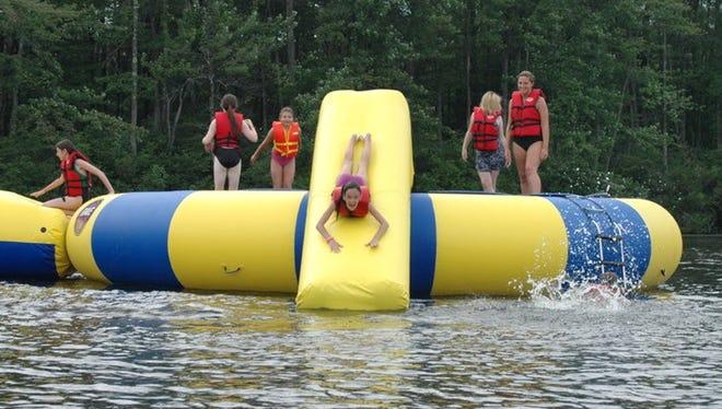 Children enjoying the water at a summer camp.