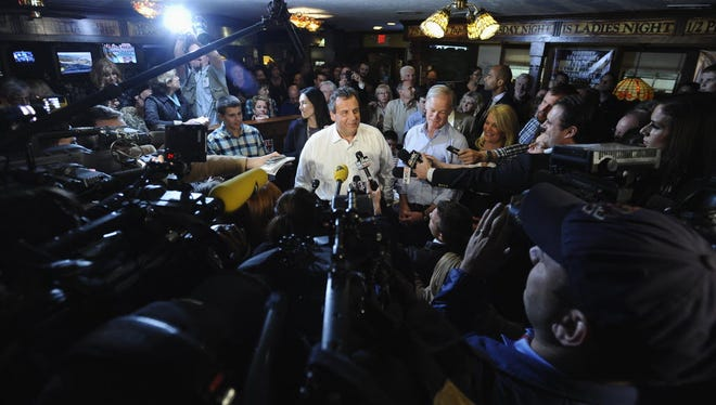 New Jersey Gov. Chris Christie answers questions from the media about nurse Kaci Hickox's quarantine as Republican candidate for Connecticut governor Tom Foley, right, listens, Monday, Oct. 27, 2014, in Groton, Conn.