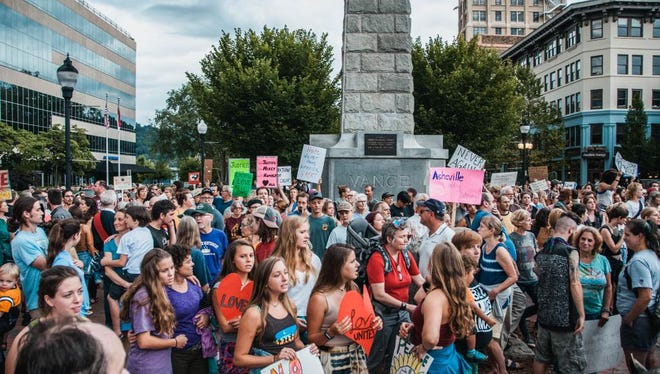A rally against white supremacists and other hate groups was held Aug. 13 around Vance Monument in downtown Asheville. Hundreds attended.
