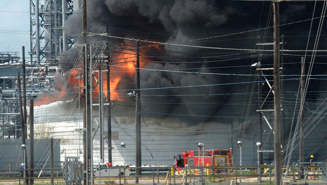 Smoke and fire rise from a heavy oil tank at Valero's Port Arthur, Texas facility Tuesday, Sept. 19, 2017. No injuries were reported in the incident. Area residents were asked to shelter in place by city officials. (Guiseppe Barranco/The Beaumont Enterprise via AP)
