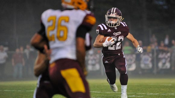 Bryce Sain (22) of Swain County runs the ball during Friday's game against Cherokee, in Bryson City. Cherokee defeated Swain County, 45-7. MIKE RICE / Citizen-Times.