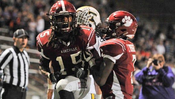 Asheville's Dana Campbell Jr.,celebrates a 2 point