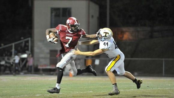 Asheville's Trevon Robinson (7) runs the ball past