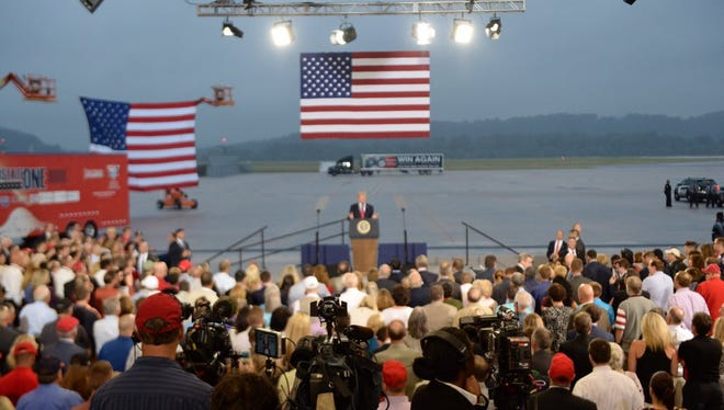 President Donald Trump addresses a crowd Wednesday evening in an Air National Guard hangar in Harrisburg.