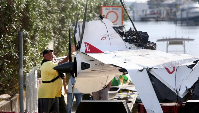 The remains of an ICON A5 airplane are moved from a boat ramp in the Gulf Harbors neighborhood of New Port Richey, Fla., on Nov. 8, 2017.  The private plane, which belonged to Roy Halladay had just been removed from the shallow waters off Ben Pilot Point in New Port Richey where it crashed Tuesday, killing the 40-year-old former Toronto Blue Jays and Philadelphia Phillies pitcher.