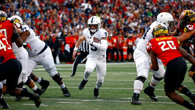 Penn State quarterback Trace McSorley (9) rushes for a touchdown in the first half of an NCAA college football game against Maryland in College Park, Md., Saturday, Nov. 25, 2017.