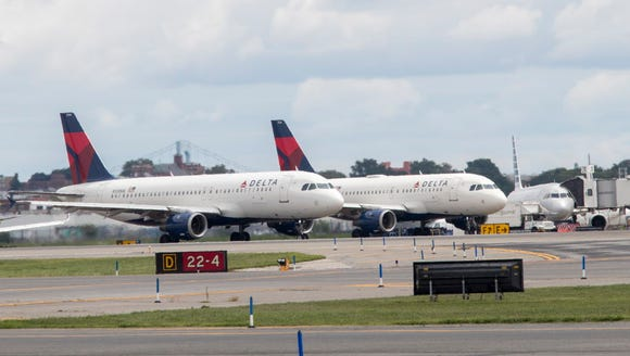 Delta Air Lines planes line the tarmac ahead of a groundbreaking
