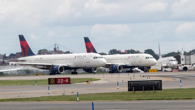 Delta Air Lines planes line the tarmac ahead of a groundbreaking ceremony of the construction on Delta Air Lines $4 billion, 37-gate facility at LaGuardia Airport on Aug. 8, 2017, in the Queens borough of New York.