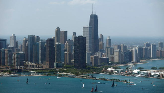 In this June 10, 2016, file photo, sailboats practice in front of the downtown Chicago skyline for an America's Cup World Series sailing event.