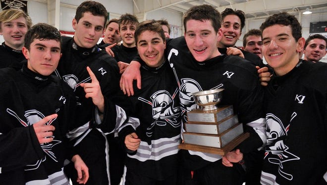 Players from the Wayne Knights celebrating their win over Lakeland in the Passaic County final at Floyd Hall Arena in Little Falls.