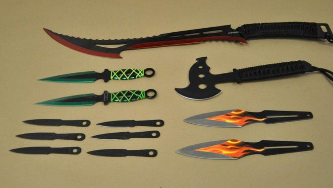 Law enforcement found 12 knives in a student's car Tuesday at Philo High School. Charges are pending against two students.
