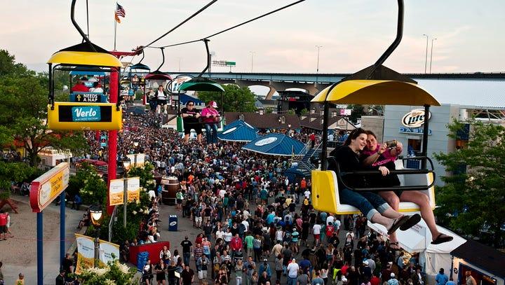 Summerfest patrons enjoy using the skyglider instead