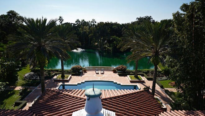 View of the pool and lake from second floor of Hacienda del Sol .