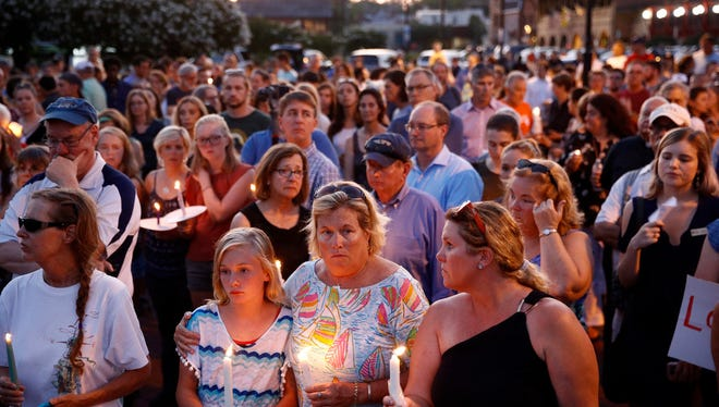 Mourners stand in silence during a vigil on June 29 in response to a shooting at the Capital Gazette newsroom,in Annapolis, Md. The shooting has columnist Joe Phalon thinking about security concerns during his time in newsrooms.