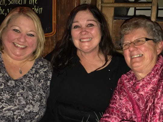 Karen Stum, center, is flanked by her newly found sister,