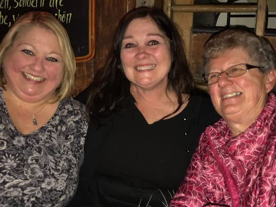 Karen Stum, center, is flanked by her newly found sister, Vicki Kleiner (left) and their half sister  Carlene Miller, right, during a recent reunion.
