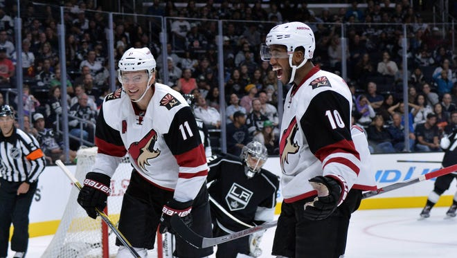 Oct 9, 2015: Arizona Coyotes center Martin Hanzal (11) and left wing Anthony Duclair (10) celebrate after a goal in the second period against the Los Angeles Kings at Staples Center.