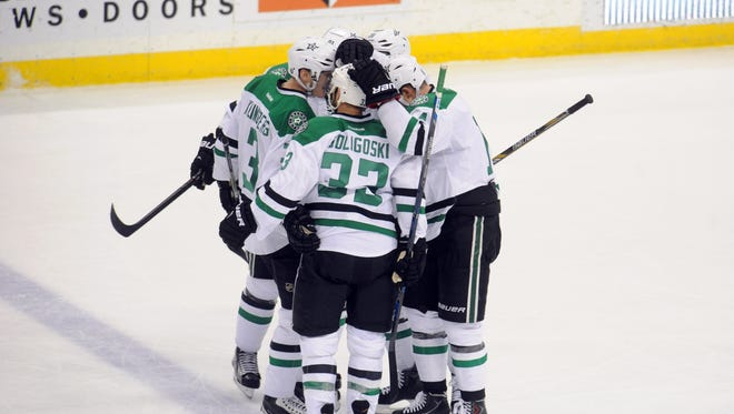 Dallas Stars celebrate a goal by Dallas Stars forward Tyler Seguin (91) tying the game during the third period against the Minnesota Wild at Xcel Energy Center.