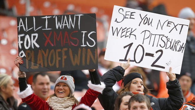 Bengals fans hold up signs in the fourth quarter of Sunday's win over the Browns.