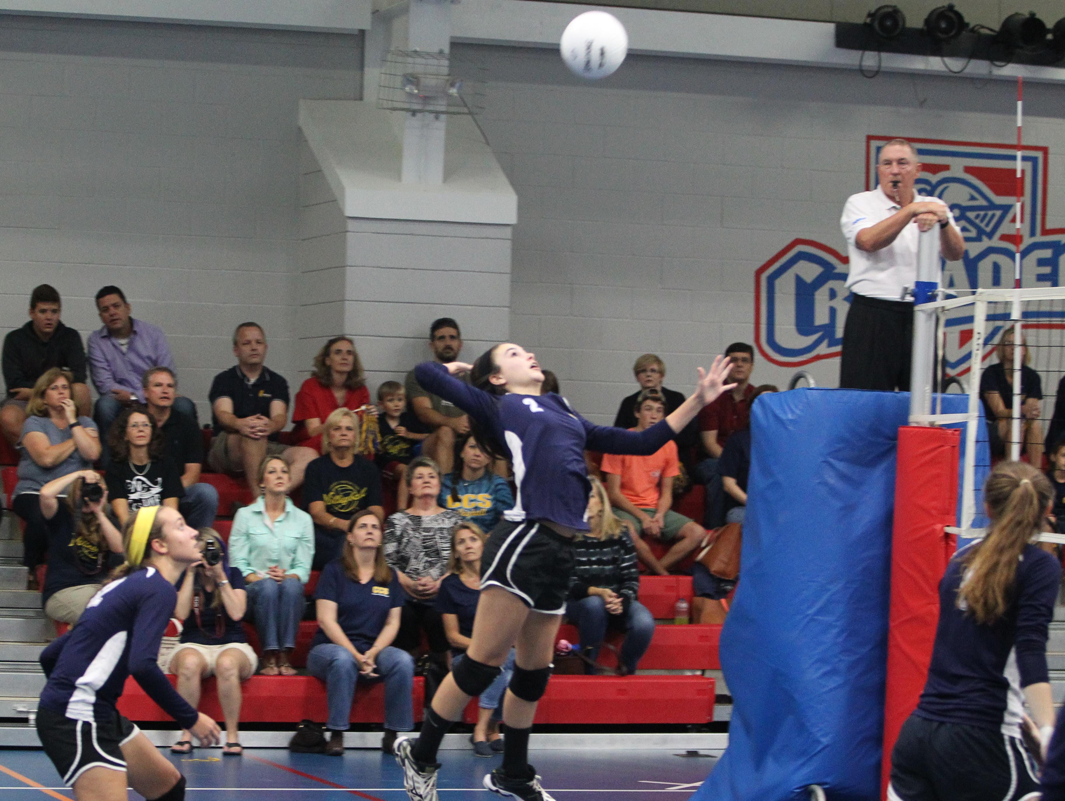 CCS eighth grader Abby Watson goes for a kill in a regional playoff game against Christ's Church Academy.