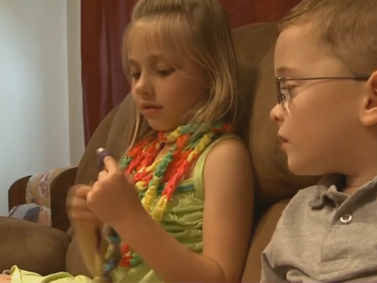 six year old makes scarves for friend