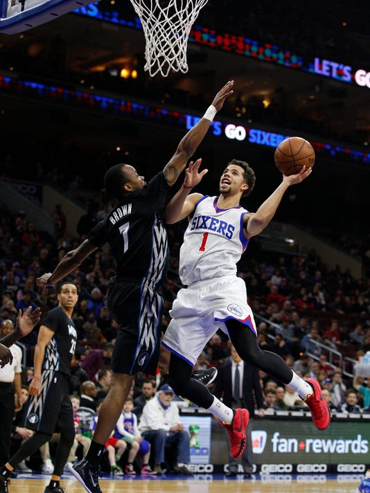 Philadelphia 76ers' Michael Carter-Williams (1) goes up for the shot against Minnesota Timberwolves' Lorenzo Brown (7) during the first half of an NBA basketball game, Friday, Jan. 30, 2015, in Philadelphia. (AP Photo/Chris Szagola)
