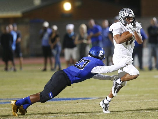 Chandler's Bryce Jackson (23) attempts to tackle Hamilton's