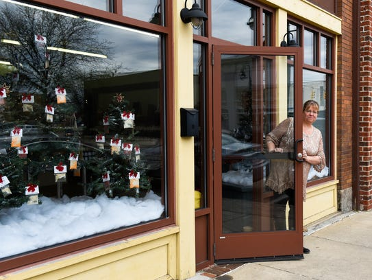 Pam Redman of Pam's Pantry inside her new storefront