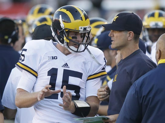 Michigan quarterback Jake Rudock (15) speaks to head