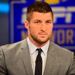 Charlotte, NC - August 6, 2014 - Charlotte Production Facility: Tim Tebow during taping of the SEC Nation Show (Photo by Phil Ellsworth / ESPN Images) [Via MerlinFTP Drop]
