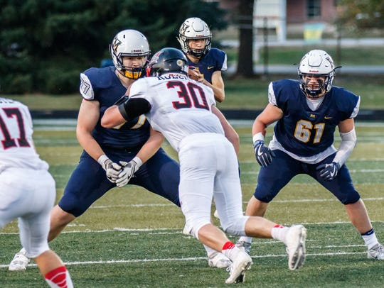 Kettle Moraine's Trey Wedig (77) shores up the offensive