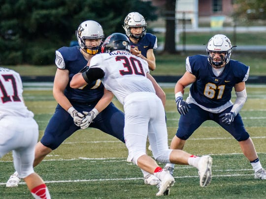 Kettle Moraine's Trey Wedig (77) shores up the offensive line during the game at home against Muskego on Friday, Sept. 15, 2017.