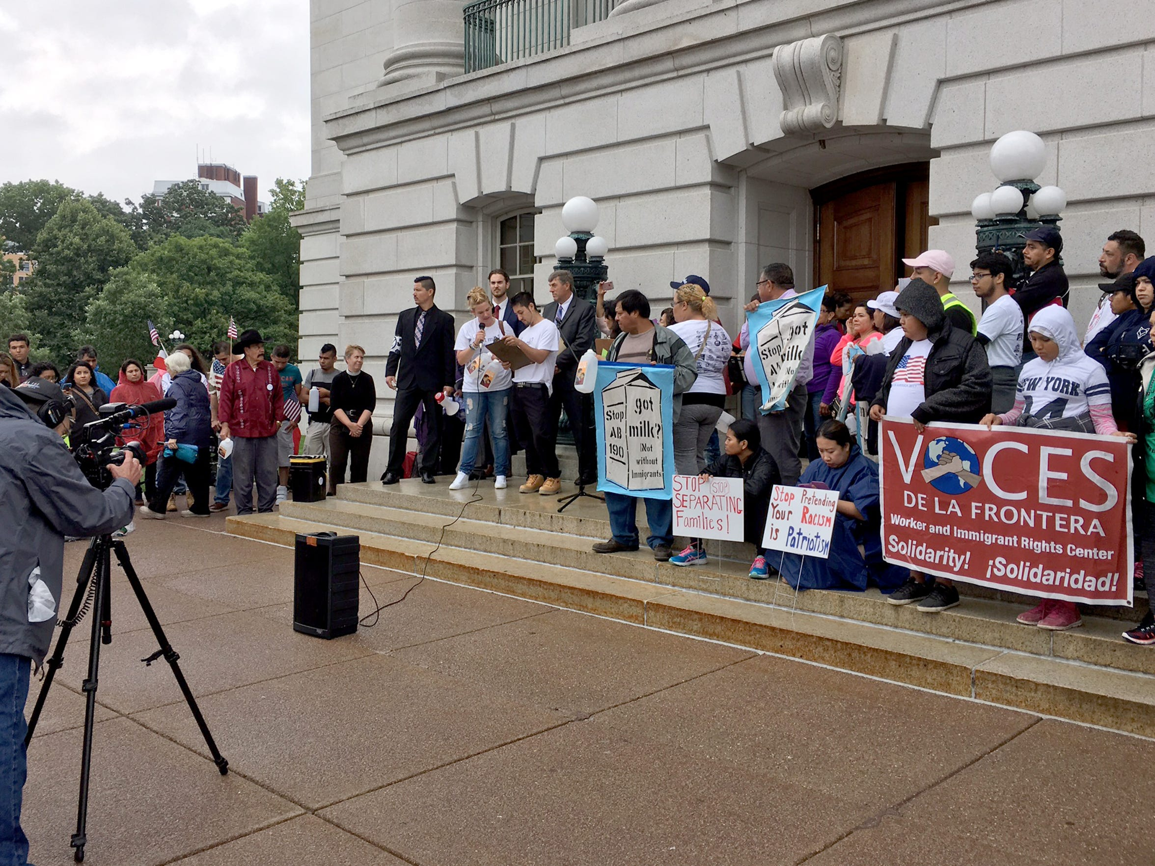 Immigrant dairy workers and their supporters, including