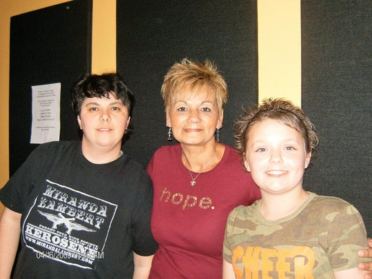 Christian NesSmith is shown with Melissa Frost (left), program director for Cenla Broadcasting, and Pat Cloud (middle).