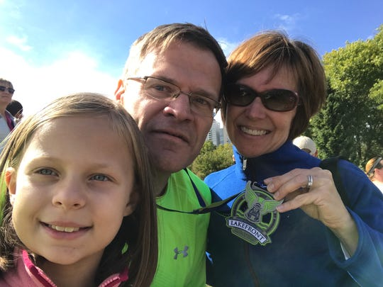 Greg Borowski, center, with his wife, Katy, and daughter, Annaliese, after completing the 2017 Lakefront Marathon.