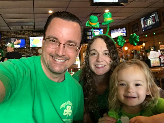 Daddy Duty columnist Tim Walters with his wife Charlotte and daughter Isabella on St. Patrick's Day.