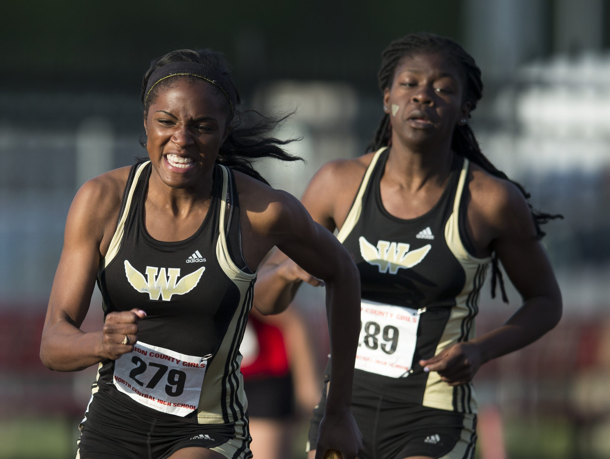 FILE -- Breana Byrdsong (left), takes a handoff from Warren Central High School teammate Jasmyne Jordan in the 4 X 100 meter relay during the Marion County Girls Track, North Central High School, Indianapolis, Tuesday, May 12, 2015.