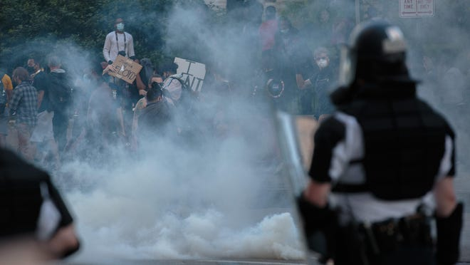 Police deployed tear gas to disperse protesters near the Statehouse on May 30.
