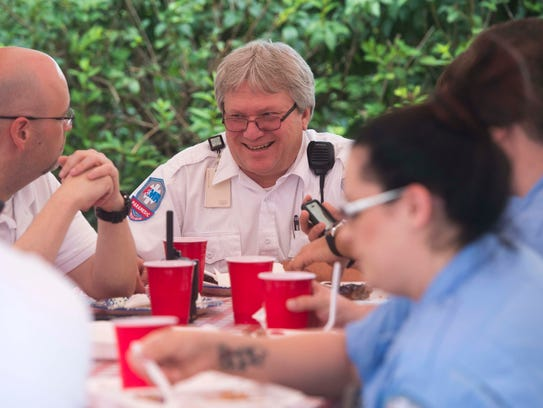 Paramedic supervisor Jim Meadows enjoys lunch at the