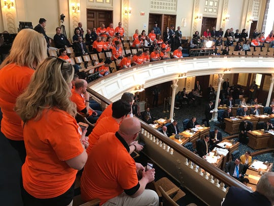 Public Service Enterprise Group employees and supporters look on from the balcony of the Assembly chamber in Trenton as Assemblyman John Burzichelli, D-Gloucester, speaks in favor of a bill that would prop up two nuclear plants owned by PSEG in Salem County. April 12, 2018.