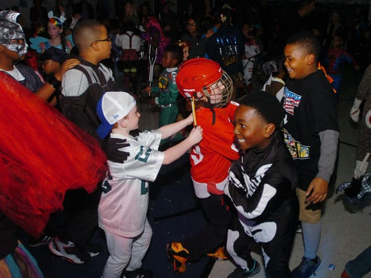 Skeletons and football players hit the floor at the annual Bingham Boo family dance.