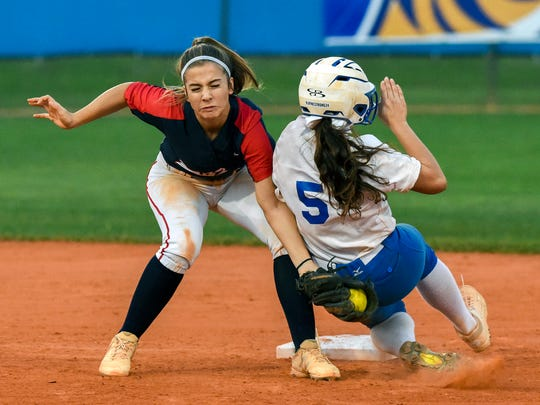 St. Lucie West Centennial's Celine Cundiff tags out Martin County's Sophia Porcelli at second base Thursday, Mar. 1, 2018, during their high school softball game at Martin County High School in Stuart. To see more photos, go to TCPalm.com.