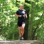 Nick Balbach, 32 of Brownsburg, is an ultramarathoner who is training for  the Western States 100-mile race in the Nevada/California mountains on June 28, 2014. Balbach runs around 60 miles six days a week and has logged over 1,200 miles since January. Balbach has been training at Eagle Creek State Park.