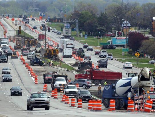 Construction crews work on the median along Moreland